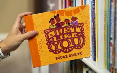 Inserting Just Like You book onto bookshelf