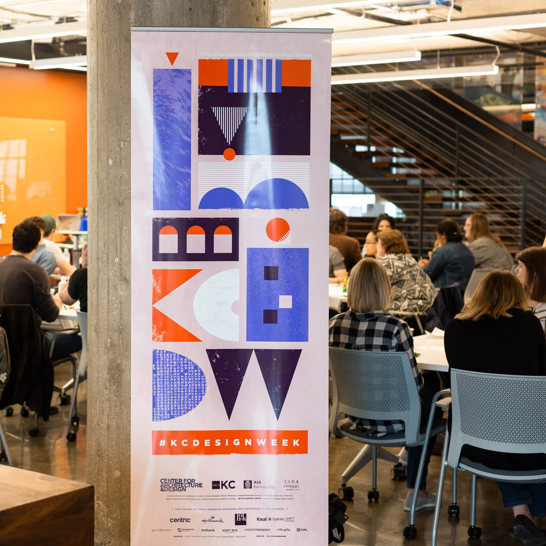 Kansas City Design Week Pull Up Banner with people in the background