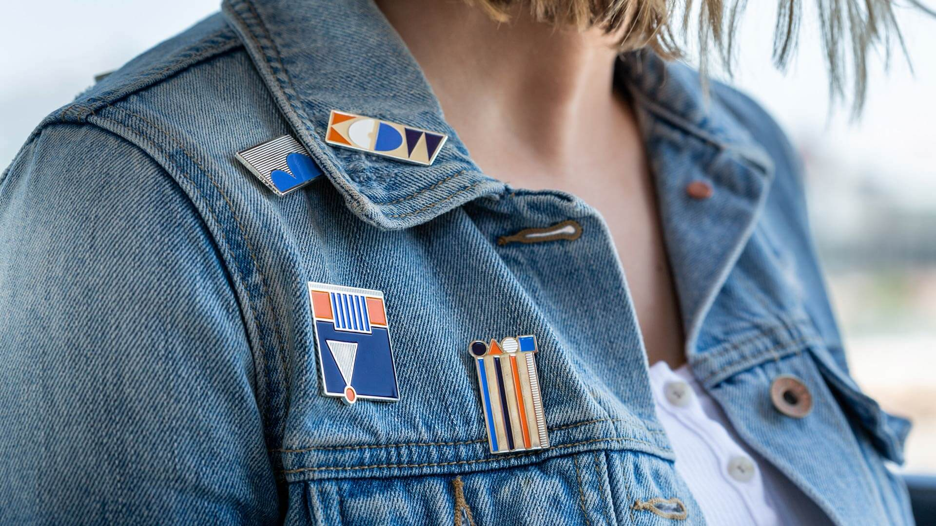 Kansas City Design Week Enamel Pins on Jeans Jacket collar
