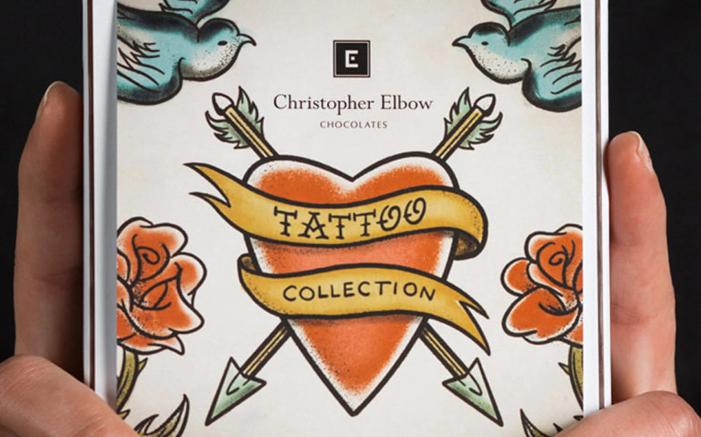 Hands holding Christopher Elbow Chocolates Valentines Tattoo Box