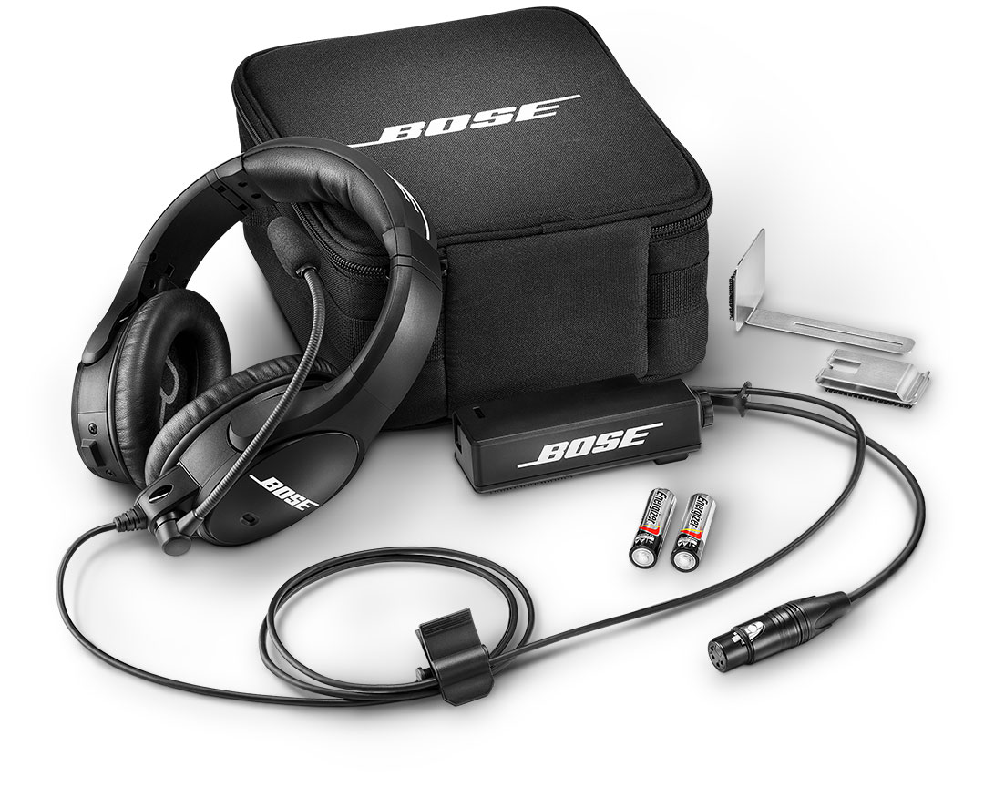 Bose SoundComm B40, carrying case and accessories fanned out on isolated white background.
