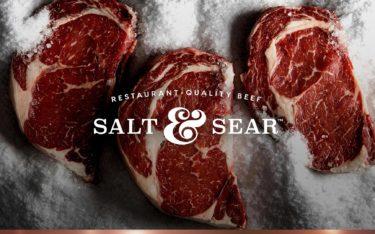 Salt & Sear Restaurant-Quality Beef branding. Logo emblazoned on ribeyes, embedded in salt.