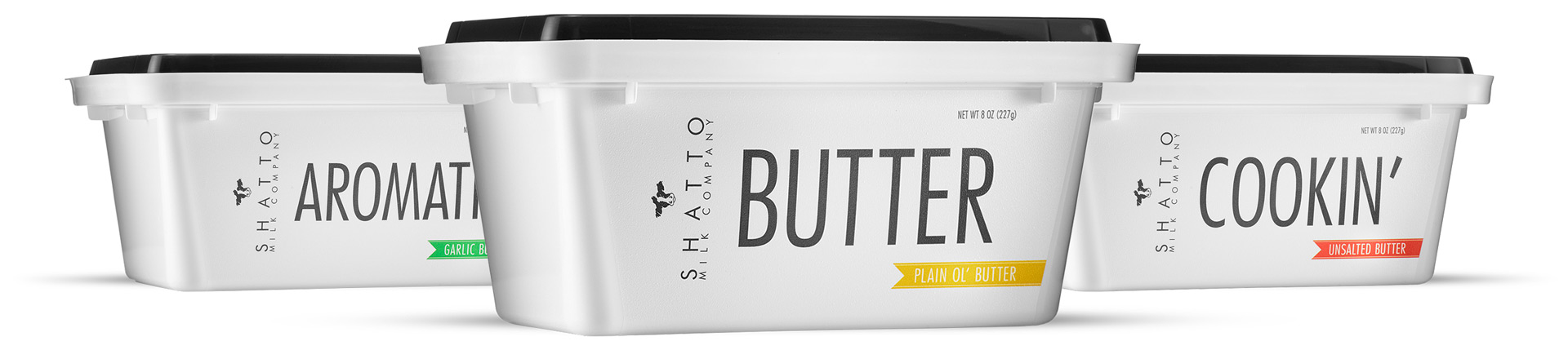 Three tubs of Shatto Milk Butter –each with large lettering that says: AROMATIC, BUTTER and COOKIN'