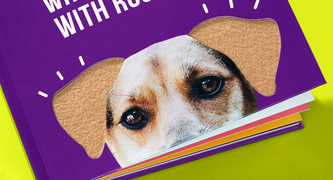 Closeup of Die cut book cover featuring felt dog ears