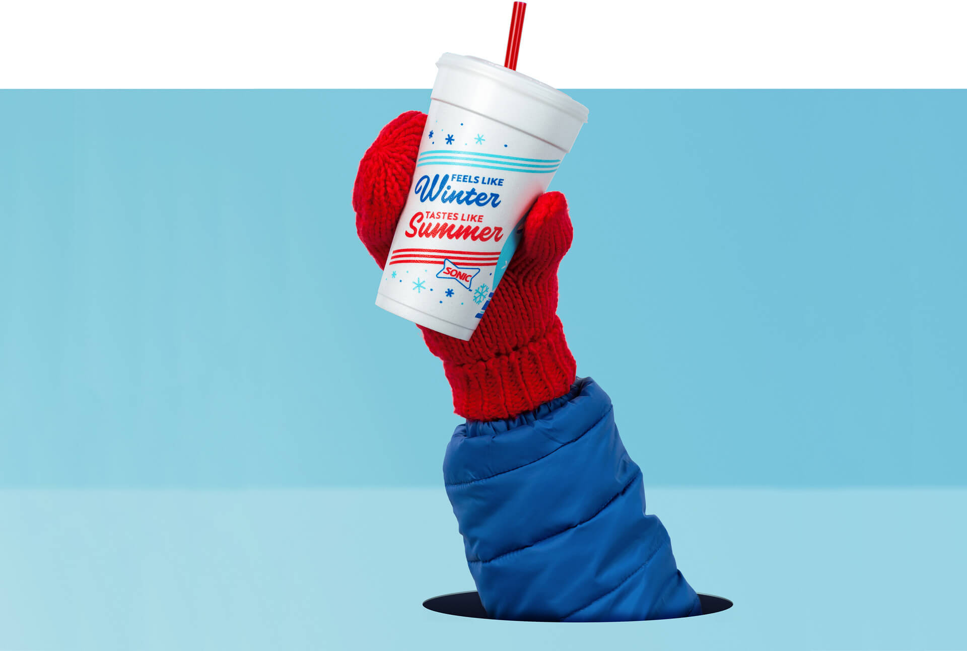 Red mittened-hand holding up a SONIC cup.